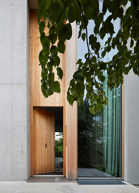 Swiss house featuring a timber-grille facade that echoes the proportions of surrounding trees.