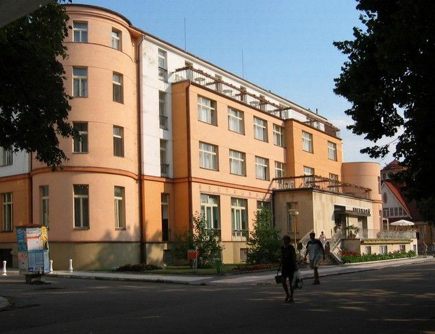Hotel Libenský is the first spa hotel and is situated in the middle of the spa colonnade.It accomodates 4 apartments, 54 singlerooms and 70 doublerooms. They are equiped with bathrooms with either a bath or shower, WC, TV/SAT, telephone and refrigerator. A Continental Breakfast, lunch and dinner are served. Situated in the hotel is the balneocentrum that hosts to part of the treatment and relax procedures.