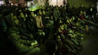 Egyptians watch the Egypt v Burkina Faso semi-final match of the Africa Cup of Nations on a large screen television in a street in the Imbaba neighborhood of Cairo, Egypt - Wednesday 1 February 2017