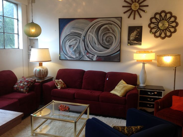 Love The Maroon Couch Against White Wall With Funky Swirly Art Loungelizardpdx