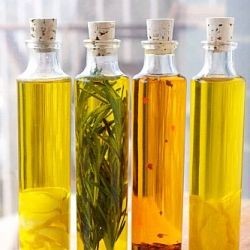 Garlic, Rosemary, Lemon, and Chili-infused olive oils -- great Christmas gifts for someone who loves to cook!
