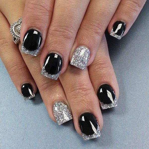 Lovely looking white and silver French tips. Coated in matte black as base, the nails are then tipped with silver glitter that simply stand out from the plain black background, the matte silver nails with glitter is also adds excitement to the eye catching ensemble.