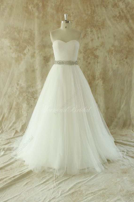 $299 you could make the skirt part a lot less full. Romantic Ivory A line wedding dress with beading by MermaidBridal