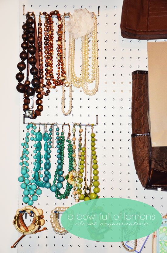 How to organize the master closet | A Bowl Full of Lemons: Using a peg board to organize jewelry, hand bags and more.