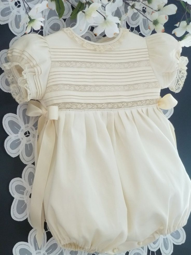 i made Christing gowns for both of my grandaughters - lot of work and a love of love in both of them.....Handmade Baby Girl Heirloom Bubble