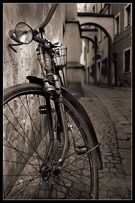 Bicycle photography; I'm imagining riding through a European city.