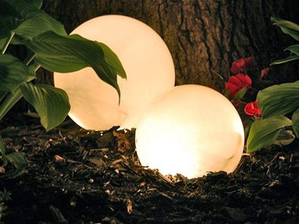 A ubiquitous globe fixture and a strand of white lights. Presto: chic, cheap outdoor lighting.