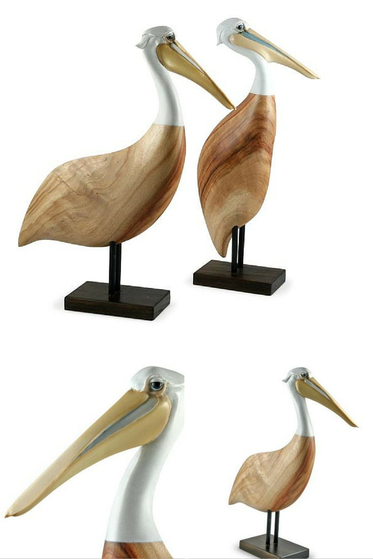 """A much loved resident of Australia's waterways. Represented here as """"Pelican Resting"""" this carving has all of the unique character and personality typical of Pelicans and those smiling eyes. The body of the bird is crafted from sustainable Camphor Laurel and the head made from resin and delicately hand painted."""