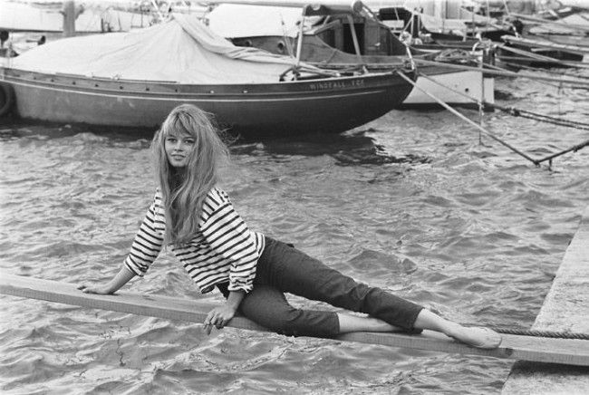 Brigitte Bardot in her classic look of breton top and cropped jeans
