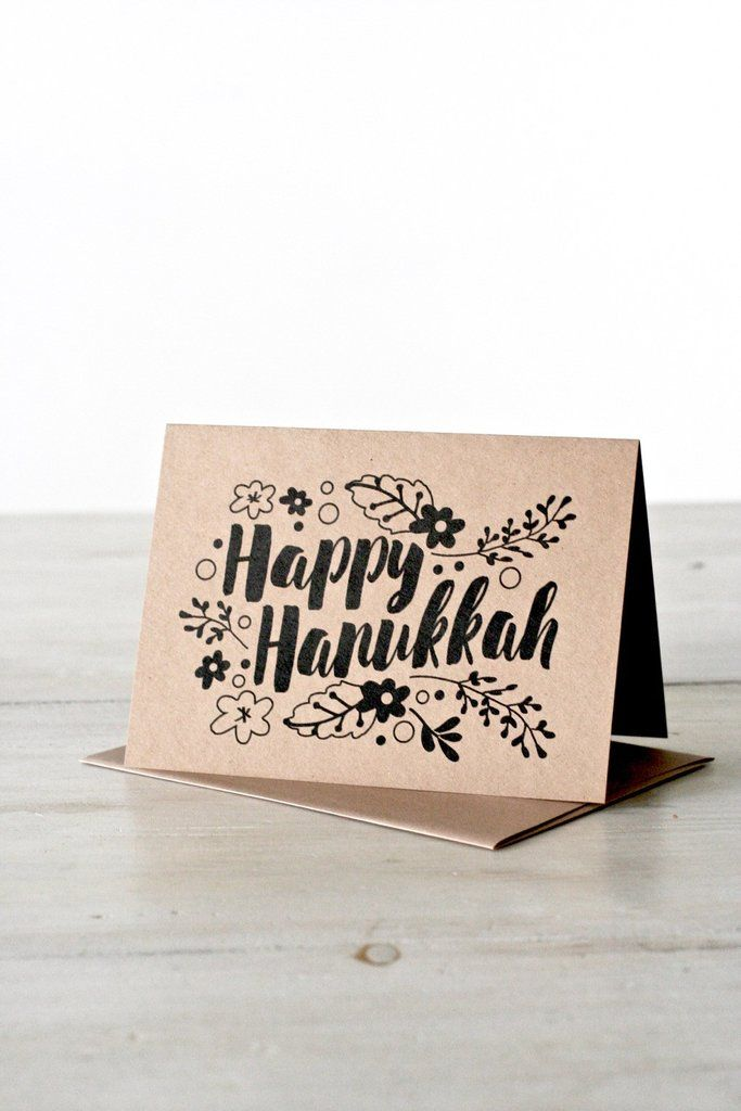 "Send Hanukkah blessings with this ""Happy Hanukkah"" greeting card. This card features beautiful typography on a luxuriously heavy kraft card stock. Choose between an individual card or a box of 6. Key"