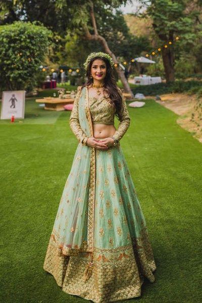 Light Lehengas - Blue and Gold Lehenga | WedMeGood #wedmegood #indianbride #indianwedding #lehenga #sangeetlehenga #lightlehenga #bridal Outfit by: Matsya