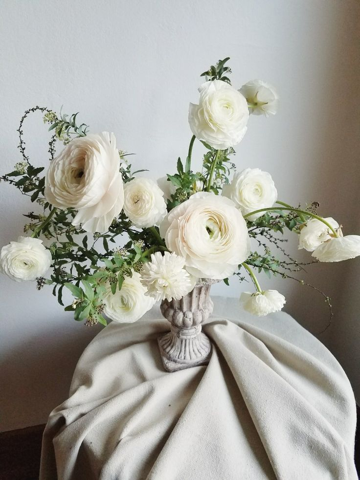 White and blush ranunculus centerpiece by Foraged Floral in Portland, OR