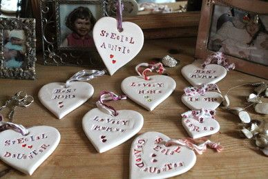 Jamali-Annay wedding heart place names doubling up as favours - featuring personalised message for each guest in the magenta/pink/purple colours of the wedding