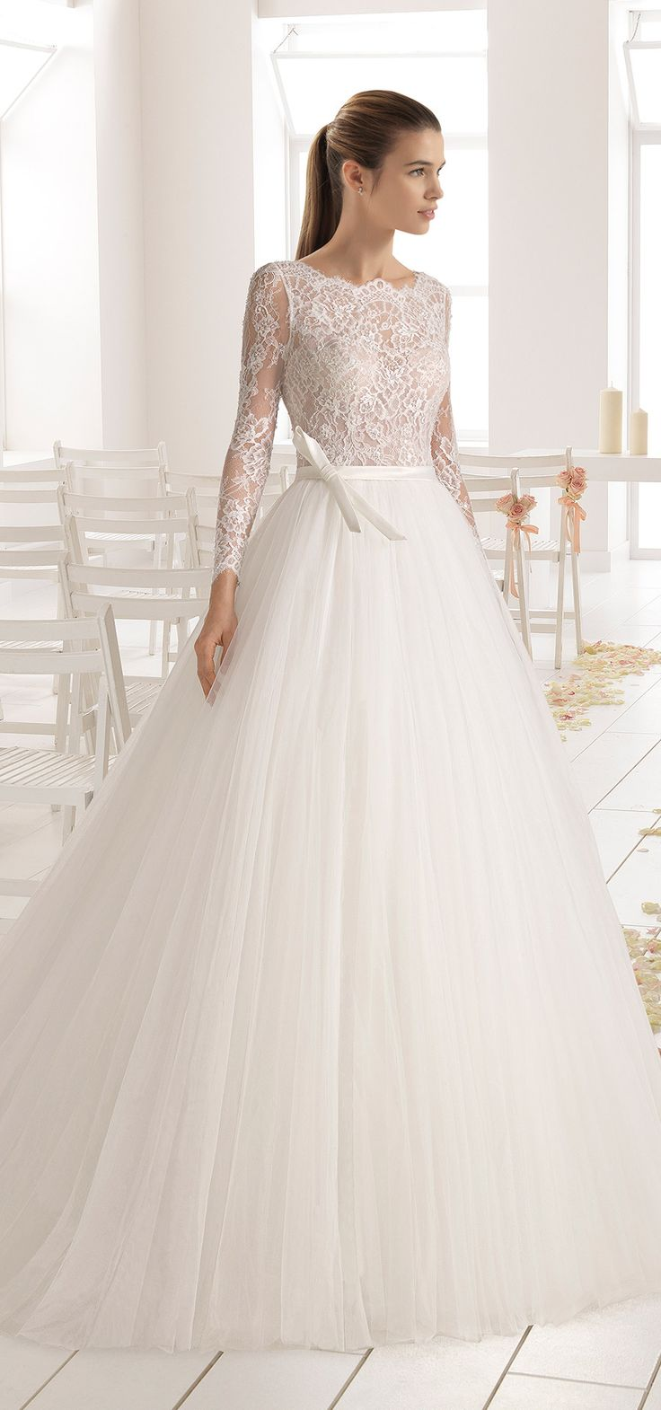 This gown is stunning! BAMBU by @airebarcelona … From the cascading tulle skirt to the delicate Chantilly lace bodice, this gown spells ROMANCE.   #GownoftheWeek #AireBarcelona #wedding #bridal #sponsored #weddingdress #ballgown  #weddinggown #romantic