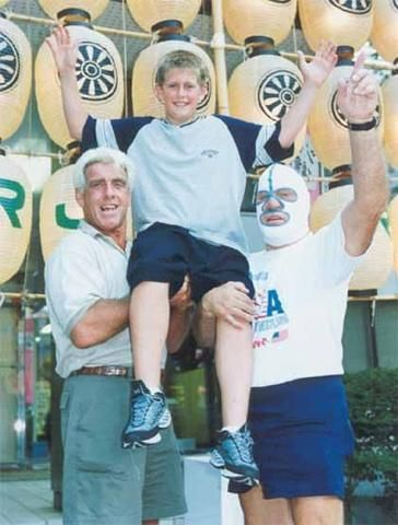Ric Flair with his young son Reid Flair in Japan. Sadly Reid passed away in 2013 at the age of 25. RIP
