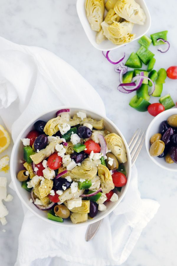 Mediterranean Artichoke Salad   Ingredients:      3 (12-ounce) jars DeLallo Marinated Artichoke Hearts, drained     1/2 cup DeLallo Pitted Seasoned Olives Jubilee     1/2 large green pepper, chopped     1/4 large red onion, thinly sliced     1/2 pint cherry tomatoes     4 ounces crumbled feta cheese        Dressing      2 tablespons DeLallo Chianti Red Wine Vinegar     1/4 cup DeLallo Extra Virgin Olive Oil     1 tablespoon chopped fresh oregano     Zest of 1 lemon     Salt and pepper to…