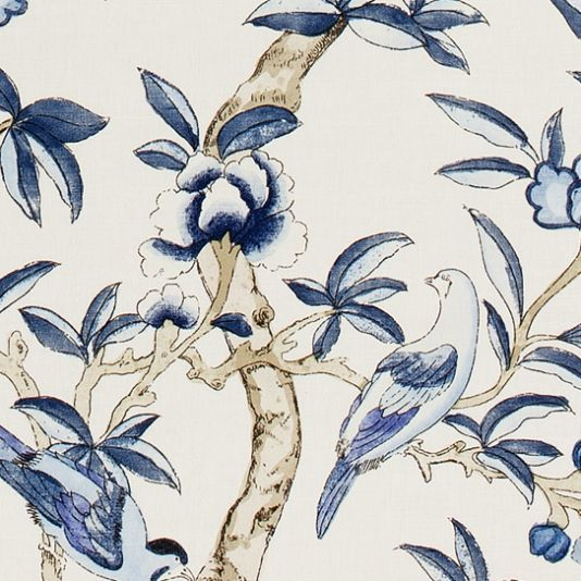 Giselle Upholstery Fabric This beautiful printed fabric features a variety of tropical birds and butterflies amongst floral branches, shown in navy blue on an off white ground.