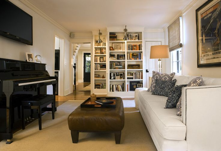 Front living room music room and library with piano and couch or