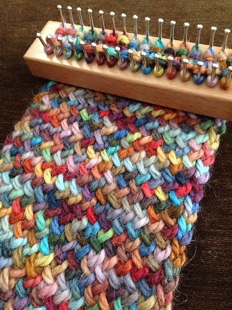 Figure eight stitch on an Authentic Knitting Board Tadpole loom. Creates a lovely double sided fabric - cross stitch on one side and stockinette on the other. The yarn is Misty Alpaca Hand Painted Chunky in Pico. by MarylinJ