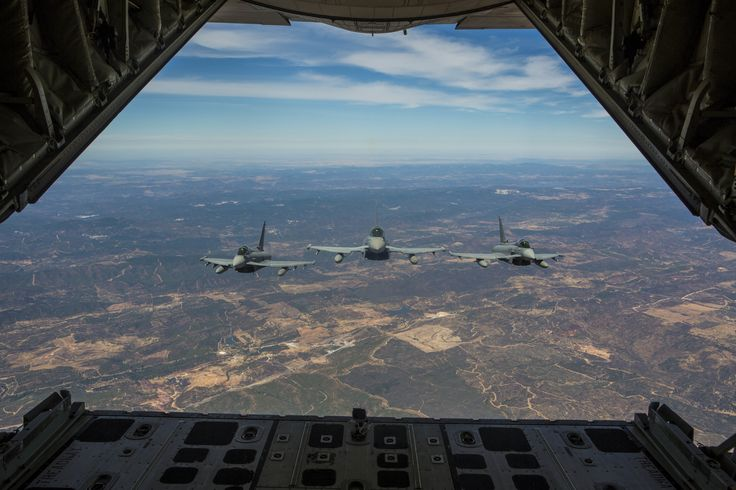 Three Spanish Air Force Eurofighter Typhoons trail a United States Marine Corps KC-130J Hercules during an aerial refueling mission [5760 x 3840]