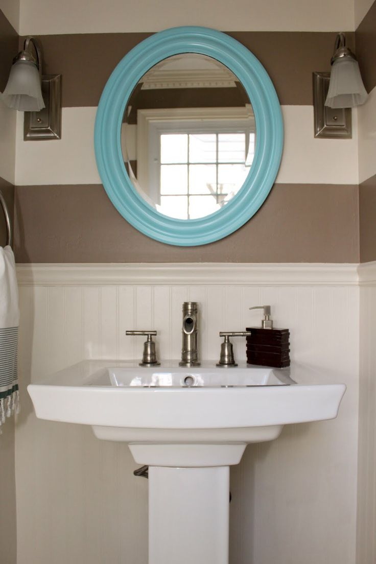 White and turquoise color scheme for bathroom storage solutions - Bathroom Unique Color Combination Between Blue Oval Window Frame And Brown Wall Painting Including White Beadboard Wainscoting As An Acce