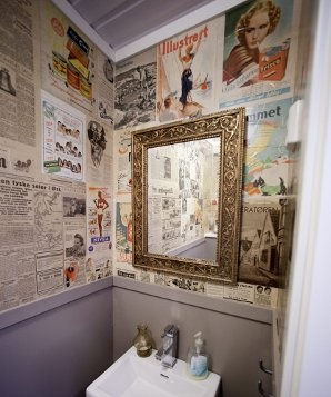 Wallpapering with old magazines and newspaper.