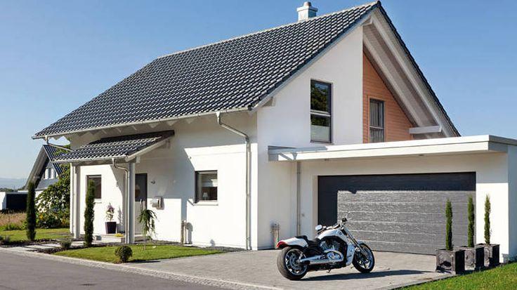 Musterhaus mit doppelgarage  Kern-Haus Familienhaus Signum Doppelgarage mit Dachterrasse ...