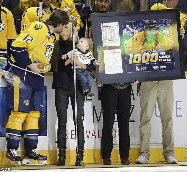 Milestone: Mike Fisher celebrated his 1,000th NHL game on Monday in Nashville, Tennessee w...