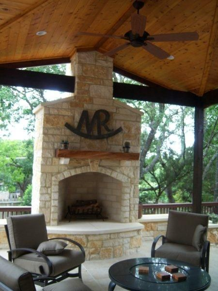 Outdoor Texas limestone fireplace.  I don't care for the limestone bt love the idea of a ceiling fan or two.