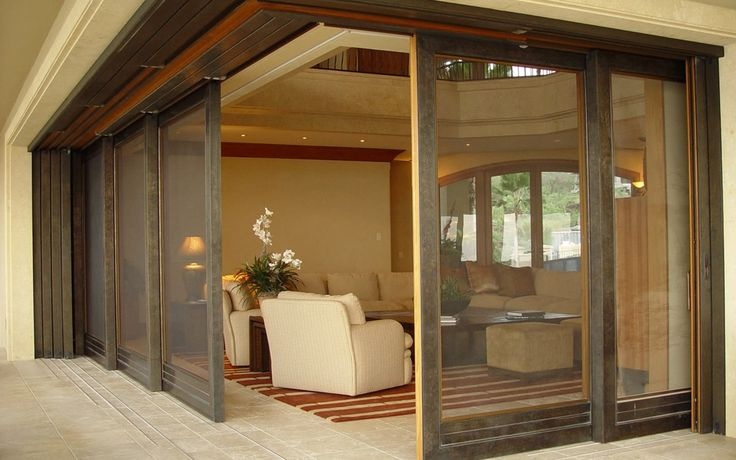 """Albertini Sliding Systems, available in extremely large sizes, too, offer """"minimal"""" thresholds, enabling virtually unobstructed passage."""