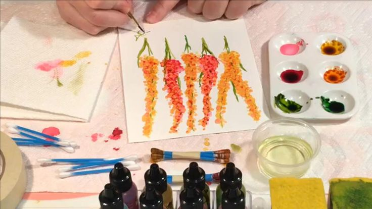 Alcohol ink artist, Laurie Williams demonstrates how to paint flowers with alcohol ink on YUPO using cotton swabs and alcohol ink.