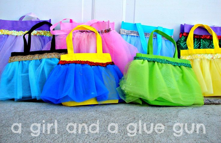 Dollar store bags, tulle (or maybe even the dollar store dress up skirts... hmm), ribbon or trimming of choice, hot glue and BAM!! Princess bags.