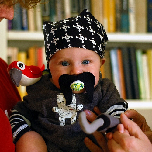 sweet pirate costume // definitely need a paci stache for JJ this year!