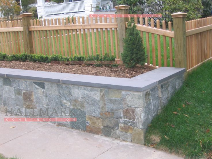 not this style or height of wall or fence, but retainer wall with fence set back a few feet like this