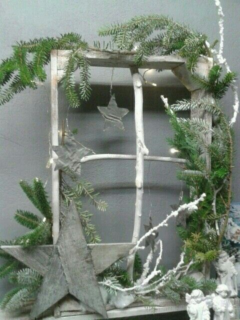 twig window with sprigs of fir and stars