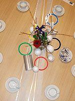 Dukat för vinter-OS med skidspår, snöbollar och OS-ringar.