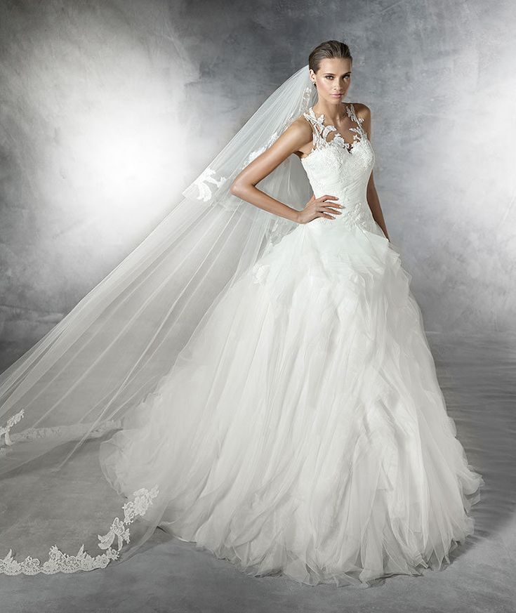 The New Design Tulle and organza A-line wedding dress with lace and guipure appliqus. Draped bodice with sheer underbodice decorated with appliqus. Sheer back decorated with lace and guipure. Organza skirt with irregular frills.  Free Measurement