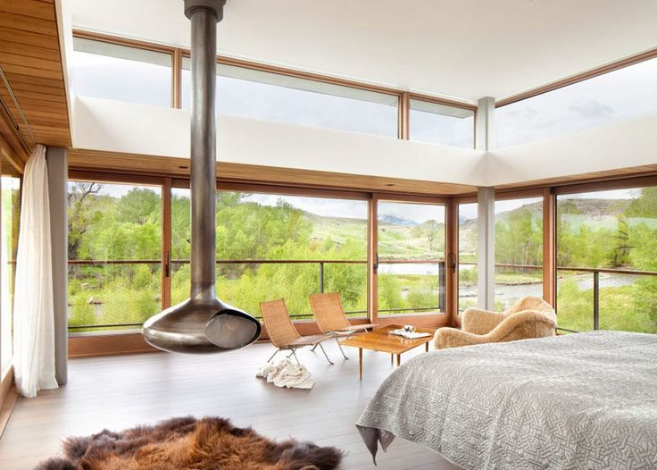 This bedroom has windows on three sides, and access to a small balcony with views of the river. A fireplace makes sure it never gets too cold in the winter.