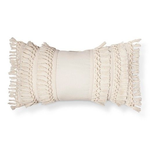 Make a chaise lounge feel luxurious with the addition of the Cream Solid Decorative Pillow from Threshold. This oblong fringe pillow has layers of tassels that lend a romantic feel.