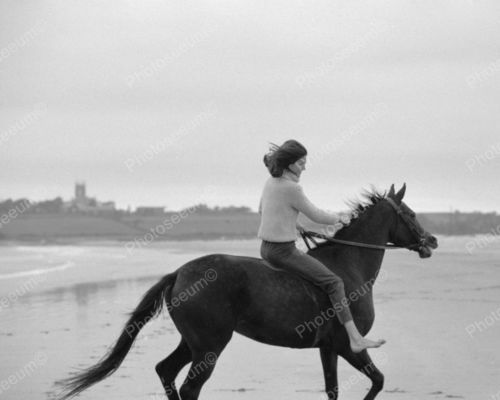 Jackie Kennedy running her horse on a beach in Ireland, 1967.