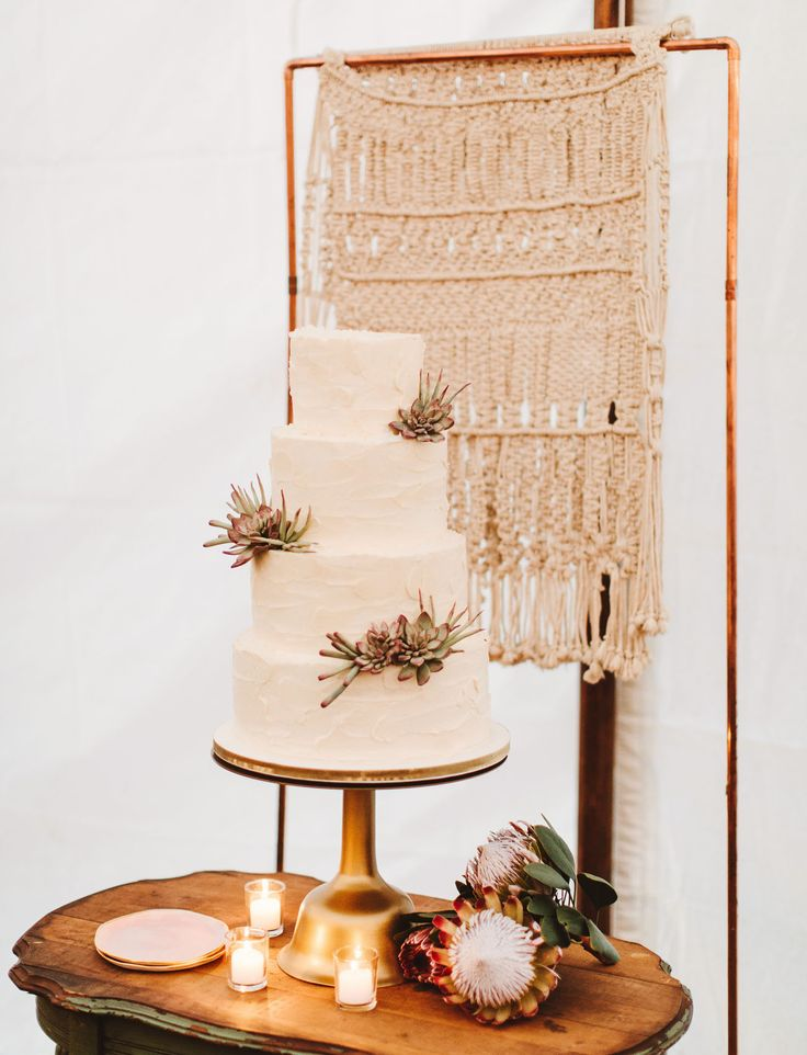 macrame backdrop and cake with succulents