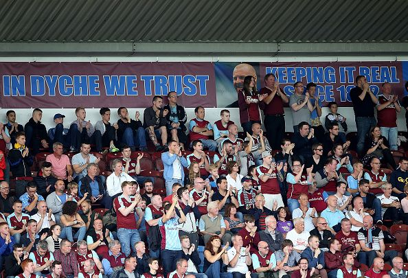 Fans cheer during the Sky Bet Championship match between Burnley and Brentford at Turf Moor on August 22, 2015 in Burnley, England.
