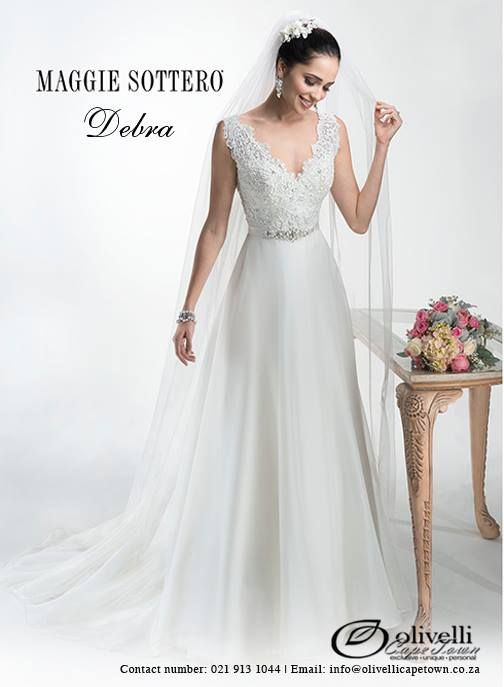 Flowing Mystique organza A-line gown with corded Alençon lace bodice, available with glittering Swarovski crystal grosgrain ribbon belt. Finished with zipper over inner elastic and covered button closure. #MaggieSottero #WeddingGown #OlivelliCT