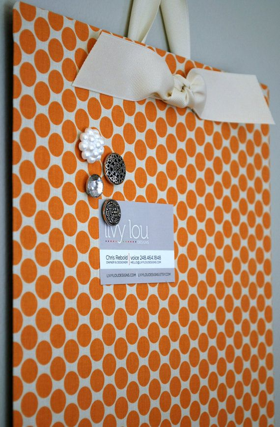 Cover a flat cookie sheet ($1 store!) with fabric and get an instant magnet board.  LOVE this!