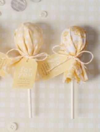 Cute favor idea: Fabric-covered lollies!