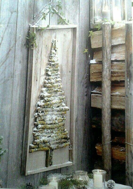 Stick Christmas tree on  a wooden frame with wood background: