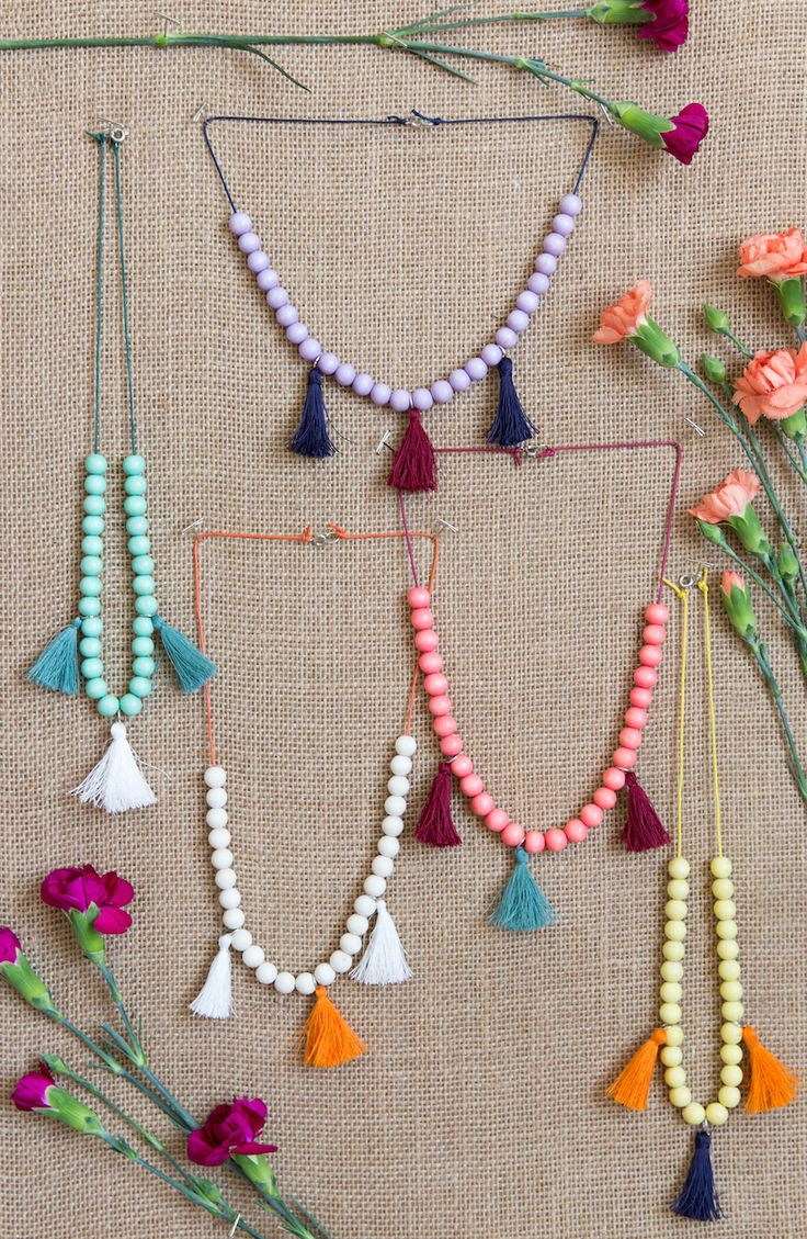 I went into making this DIY fully intent on gifting the necklaces to little Phoebe, but by the time they were finished, she practically had to pry them out of my hands. They just turned out too ado...