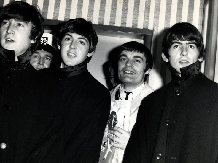 It's been 50 years today since The Beatles touched down in Sydney - Members of band 'The Beatles' (L-R) John Lennon, Paul McCartney, Jimmy Nicol (filling in for ringo Starr who was sick) and George Harrison during their tour of Australia in a 1964 photo. Picture: News Corp