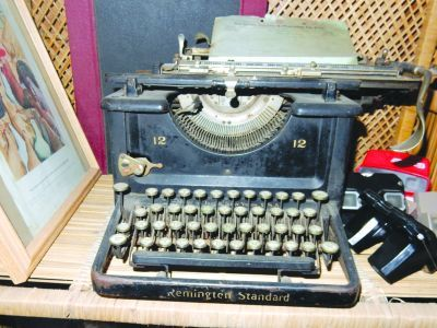 """An old Remington typewriter sits on a wicker shelf in Sid's home, nestled among vintage 1950s View-Masters stereoscopes. """"That typewriter is probably from the 1920s,"""" says Sid. """"I've had that old typewriter for a long time."""""""