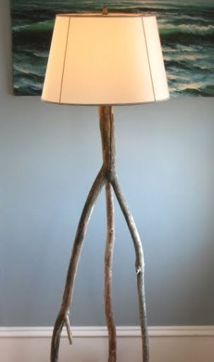 How to make a floor lamp with wood branches: http://www.completely-coastal.com/2012/01/diy-lamp-tutorial-making-tripod-floor.html I used driftwood branches for this tripod floor lamp.